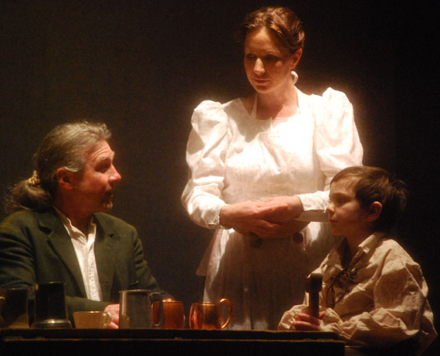 Bob and Mrs. Cratchit with Tiny Tim played by Mike Delaney, Gail Golec and Holden Perron